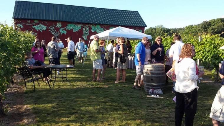 wine tasting in front of barn