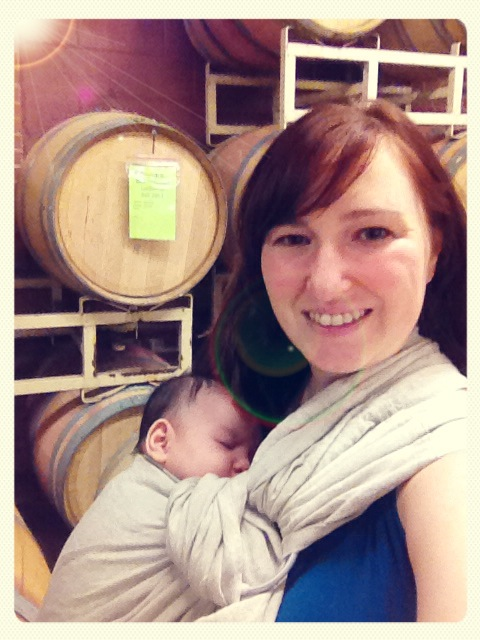 amanda-and-baby-jp-in-front-of-barrels